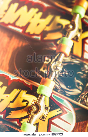 Closeup on a bunch of toy skateboards with wheels trucks and decks upside down. Skateboarding cool - Stock Image
