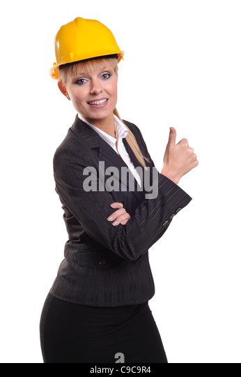 Business Lady in safety hat giving the thumbs up sign - Stock Image