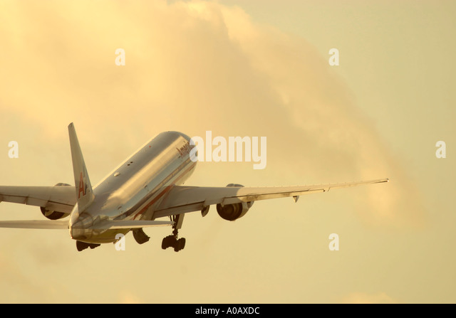 Commercial airplane after take off - Stock Image