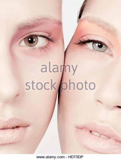 Models cheek to cheek. - Stock Image