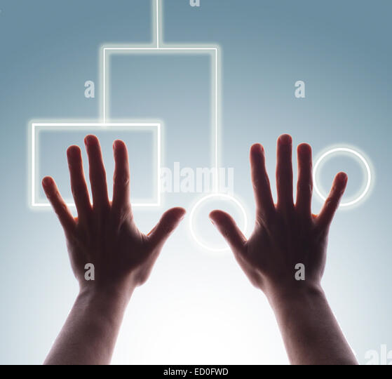 Studio shot of man's hands touching digital touch screen buttons - Stock Image