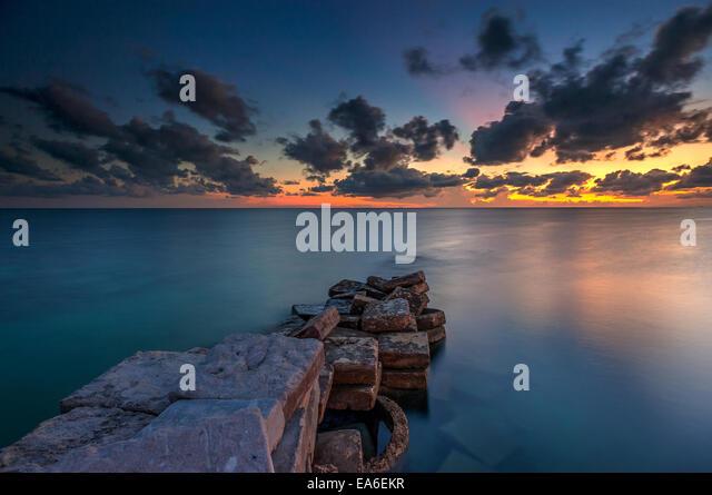Malaysia, Sabah, Ray of Light sunset at Mabul Island - Stock Image