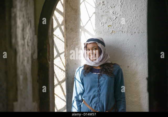 Student in period dress at castle - Stock Image