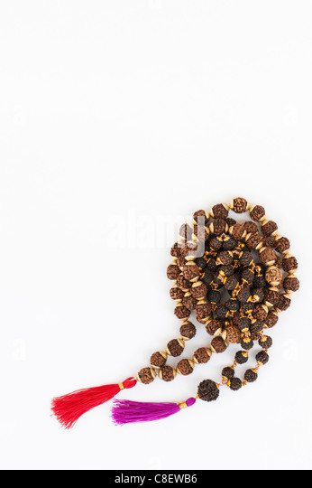 Indian Rudraksha / Japa Mala prayer beads on white background - Stock Image