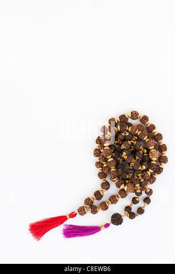 Indian Rudraksha / Japa Mala prayer beads on white background - Stock Image