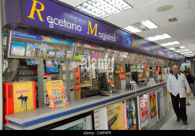 Chile Santiago Providencia Avenida Vicuna Mackenna Farmacias Ahumada pharmacy drugstore chain business counter Hispanic - Stock Image