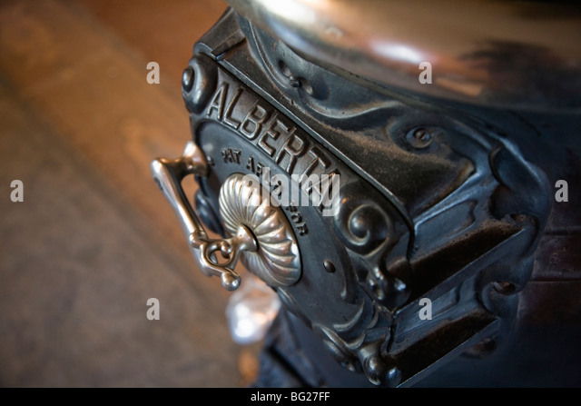 Antique cast iron wood burning stove on display in the Murakami House, Britannia Heritage Shipyard, Richmond, BC, - Stock Image