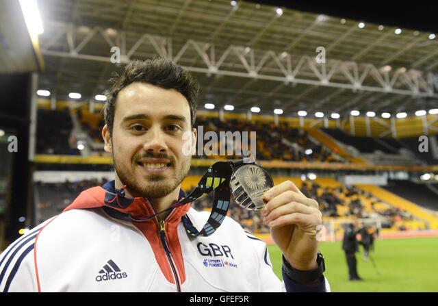 British artistic gymnast Kristian Thomas with his World Championship gold medal - Stock-Bilder