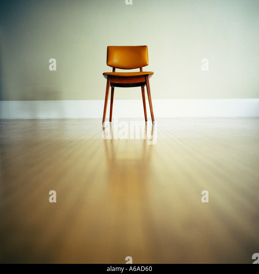 Single Chair In An Empty Room - Stock Image