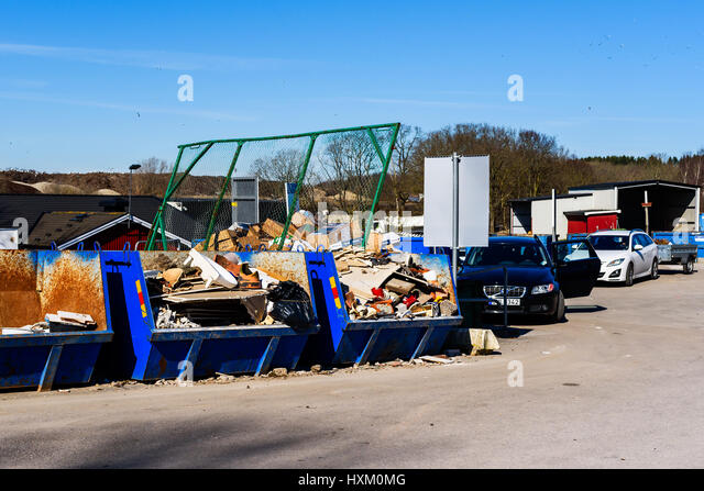 Ronneby, Sweden - March 27, 2017: Documentary of waste management. Cars with trailers at public waste station. Containers - Stock Image