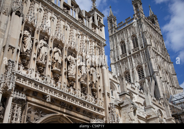 Gloucester Cathedral central tower and close-up of carved figures on SW porch, Gloucester, Gloucestershire, England, - Stock Image