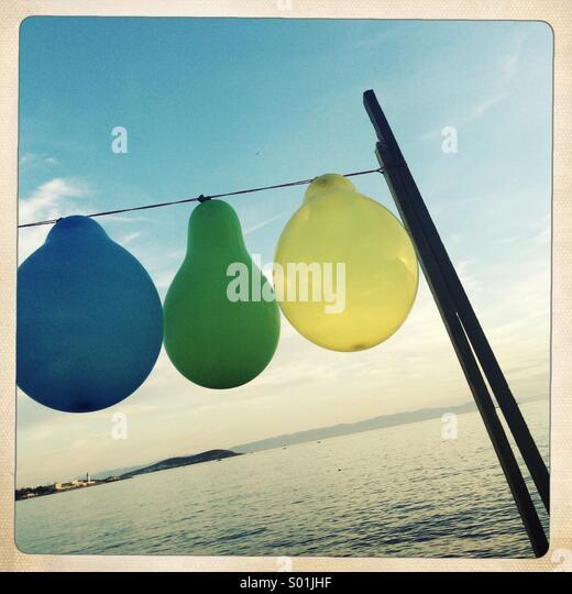 Balloons on seaside - Stock Image