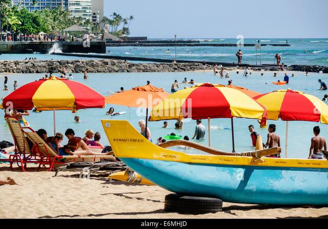 Hawaii Hawaiian Honolulu Waikiki Beach Pacific Ocean Kuhio Beach Park waterfront sunbathers swimmers bathers sand - Stock Image