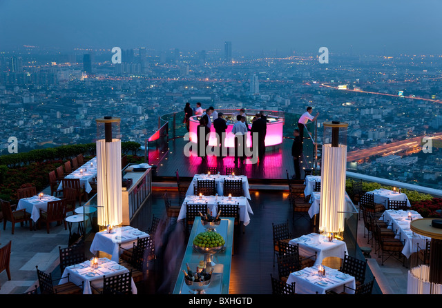 View over open air-bar 'Sirocco Sky Bar' and Bangkok in the evening, State Tower, 247 m, The Dome, Bangkok, - Stock Image