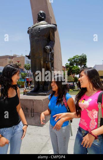 Peru Tacna Calle San Martin Plaza de Armas public park square Arco Parabolico parabolic arch monument statue bronze - Stock Image