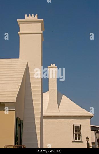 Bermuda white washed ribbed roof  chimneys Bermudan national symbol iconic image st george town - Stock Image