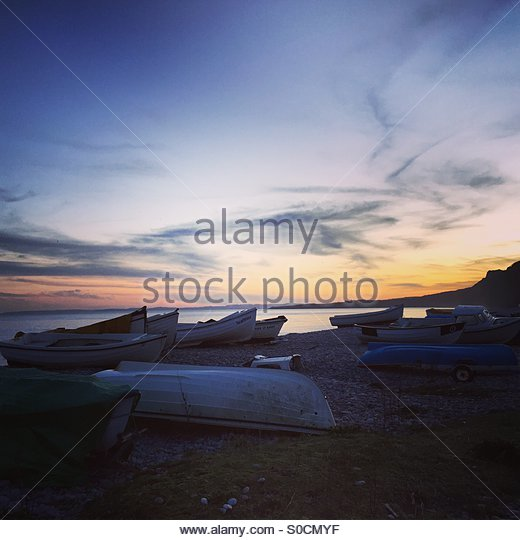 Sunset on Budleigh Beach - Stock Image