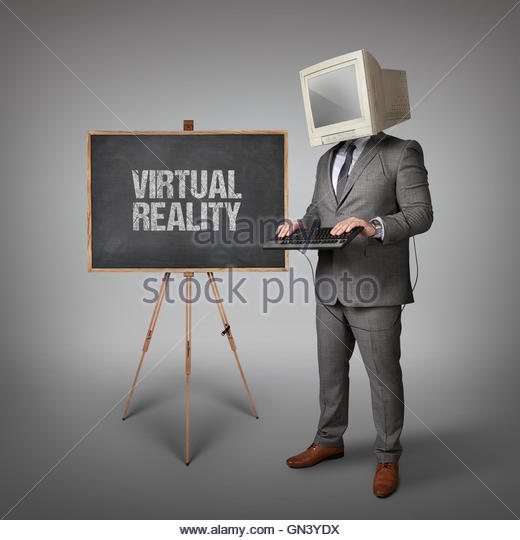 Virtual Reality text on blackboard with businessman - Stock Image