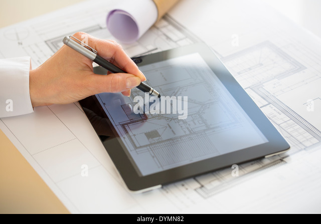 Close-up Of Hands Architect Woman Drawing with stylus on Digital Tablet - Stock Image