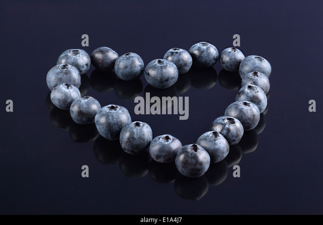 Fresh Blueberries arranged in the shape of a Heart - Stock Image