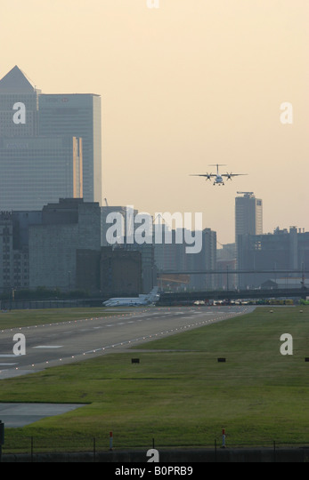 Regional airplane on short final at London City Airport, England, UK. - Stock Image