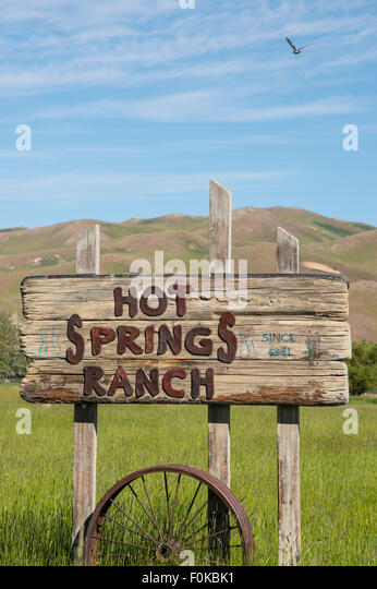 Hot Spring Ranch, Red Barn and Horses Grazing near Soldier-Smokey Mountains Camas-Fairfield area, Idaho, USA - Stock Image