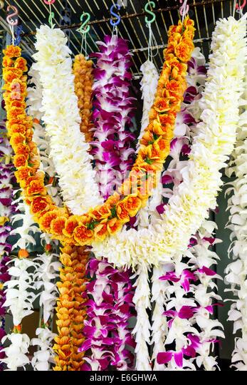 Hawaii Oahu Hawaiian Honolulu Chinatown Maunakea Street shopping flower leis display sale - Stock Image