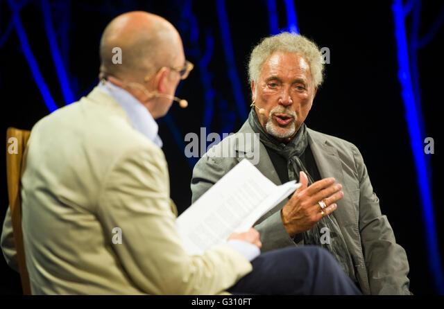 Tom Jones speaking on stage interviewed by Dylan Jones at Hay Festival 2016 - Stock Image