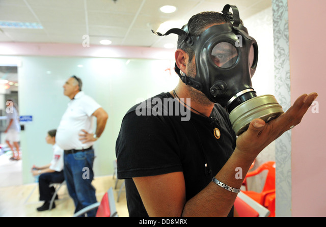Israeli man testing gas mask - Stock Image