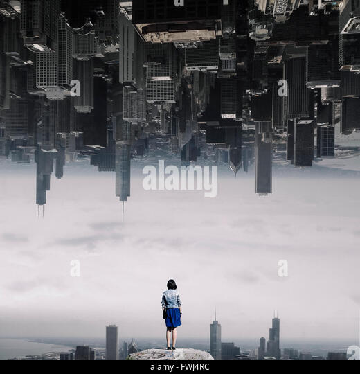 Rear View Of Woman Overlooking Cityscape - Stock-Bilder