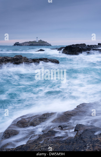 Crashing Atlantic waves near Godrevy Lighthouse, Cornwall, England. Winter (February) 2013. - Stock Image