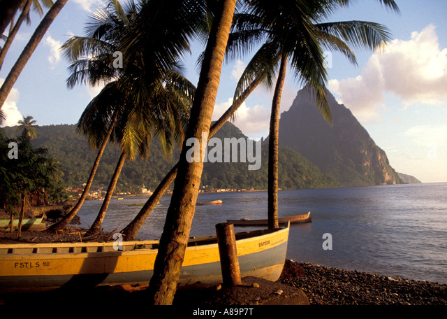 St Lucia beach petit piton mountain yellow fishing boat Soufriere Beach Saint Lucia iconic image - Stock Image