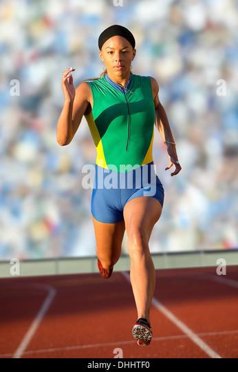 Runner racing on track - Stock Image