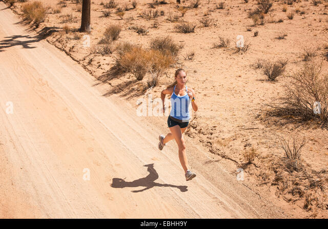 Woman running, Joshua Tree National Park, California, US - Stock-Bilder