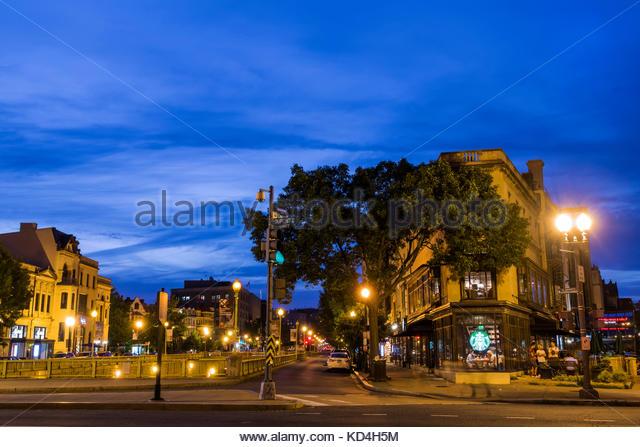 Washington DC District of Columbia Dupont Circle Starbucks Coffee dusk street view night nightlife - Stock Image