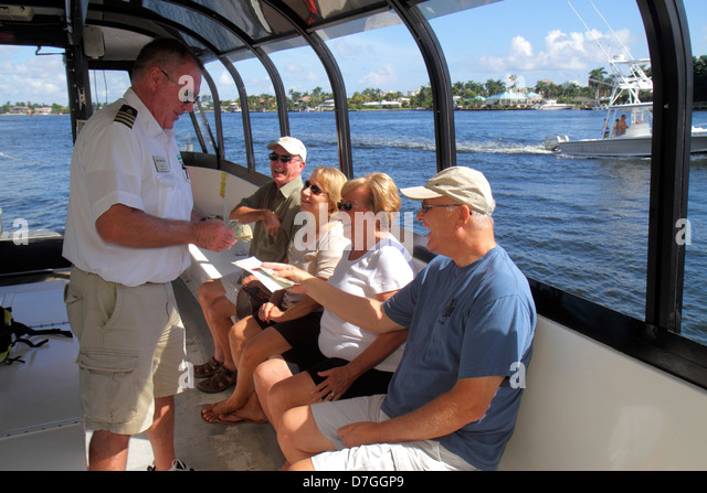 Fort Lauderdale Florida Ft. Intracoastal Waterway The Water Taxi passengers crew captain guide man woman couple - Stock Image