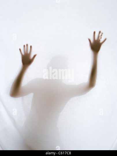 Silhouette of man behind sheet. - Stock-Bilder