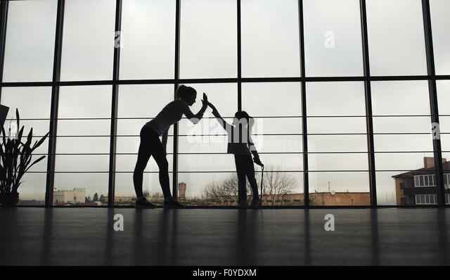 Charming family spends time in the gym - Stock-Bilder