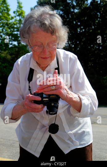 Maine Ogunquit senior woman digital camera hobby active - Stock Image