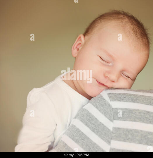Newborn baby boy is tired and sleepy - Stock Image