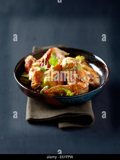 Chicken wings with honey and ginger - Stock Image
