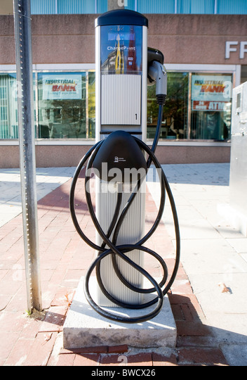 An electric car charging station and parking space.  - Stock Image