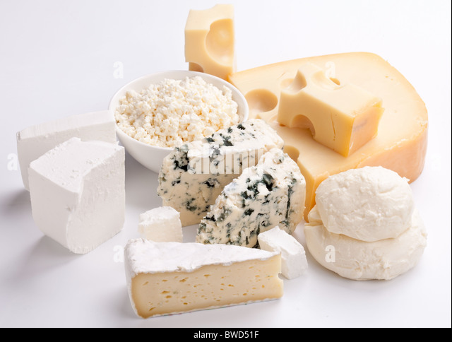 Various types of cheeses on a white background. - Stock Image