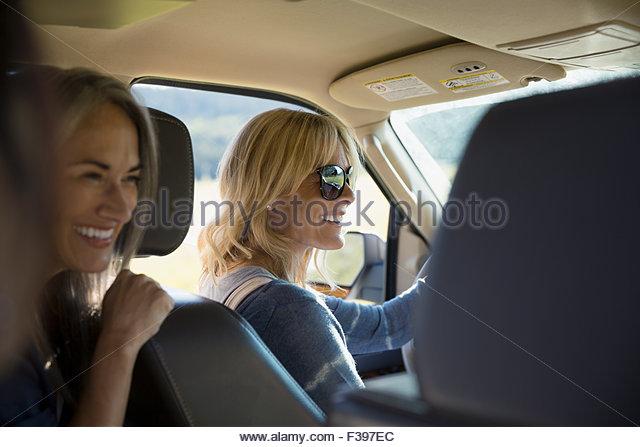 Smiling women driving in car - Stock Image