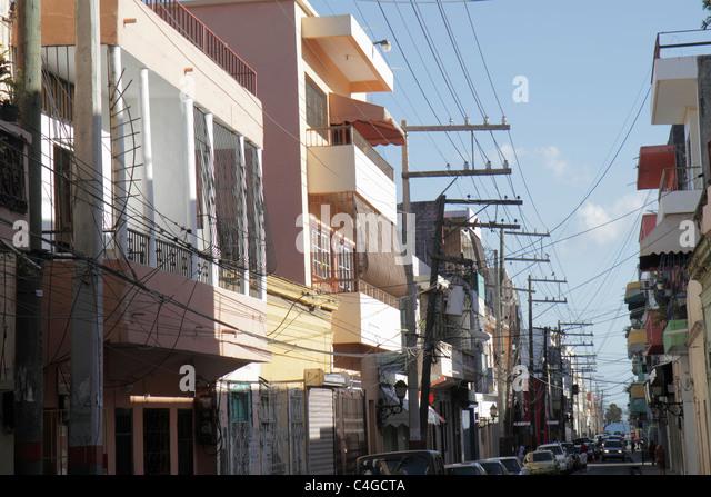 Santo Domingo Dominican Republic Ciudad Colonia Calle Santome neighborhood building urban power cables utility poles - Stock Image