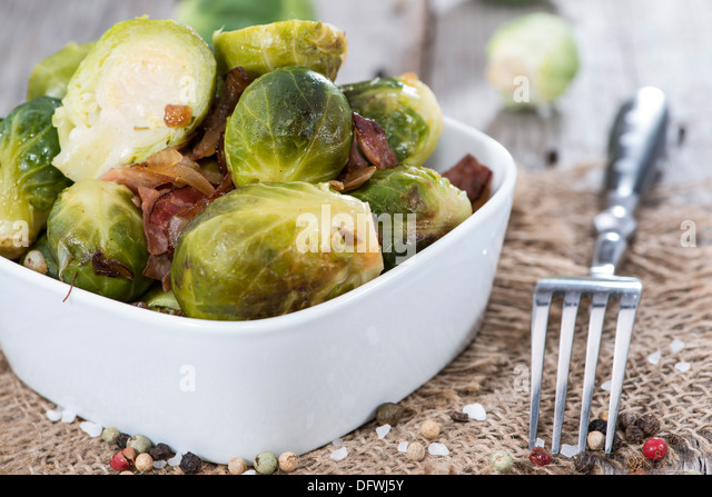 Fried Brussel Sprouts with Ham and Onions - Stock Image