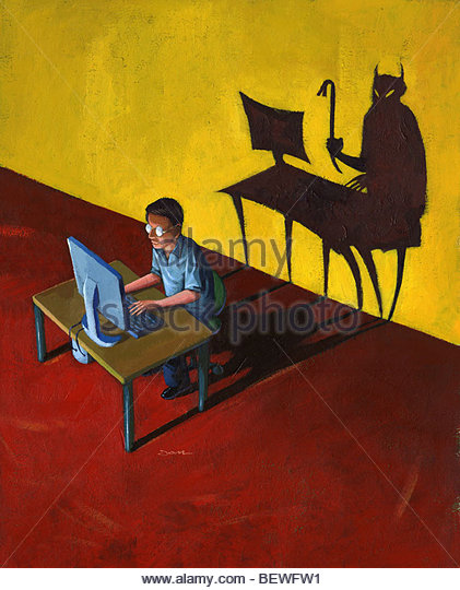 Devil lurking behind man on computer - Stock Image