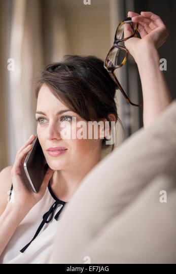 Beautiful woman talking on a mobile phone - Stock-Bilder