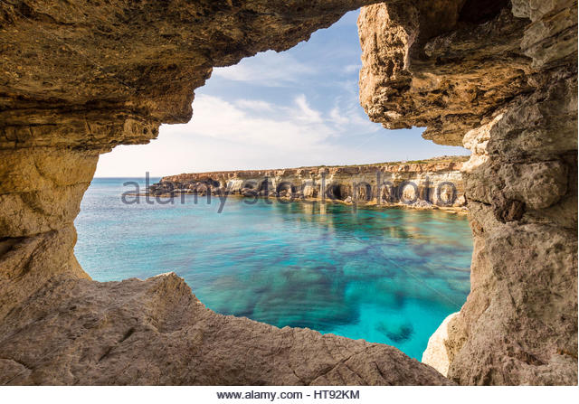 Sea Caves along Rocky Coast by Mediterranean Sea at Sunset, Cape Greco, National Forest Park, Ayia Napa, Cyprus - Stock-Bilder