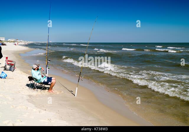 Surf fishing rod stock photos surf fishing rod stock for Gulf shores alabama fishing